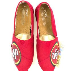 """<a href=""""https://www.etsy.com/listing/168716601/customized-san-francisco-49ers-toms?ref=sr_gallery_27&ga_search_query=san+francisco+49ers&ga_page=3&ga_search_type=all&ga_view_type=gallery""""> Niners Toms</a>, $99.99."""