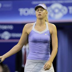 Maria Sharapova of Russia reacts during the quarterfinal at the Pan Pacific Open Tennis against Samantha Stosur of Australia in Tokyo, Thursday, Sept. 27, 2012.