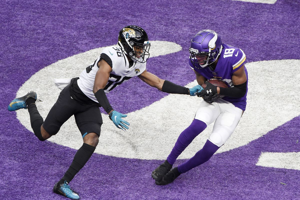 Justin Jefferson #18 of the Minnesota Vikings makes a touchdown catch as Luq Barcoo #36 of the Jacksonville Jaguars defends in the third quarter at U.S. Bank Stadium on December 06, 2020 in Minneapolis, Minnesota.
