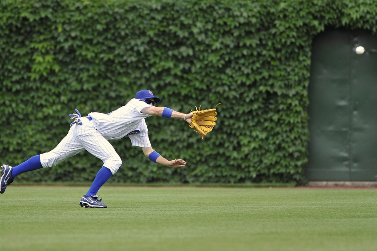 Center fielder Tony Campana of the Chicago Cubs makes a diving catch on a line drive hit by Chris Iannetta of the Colorado Rockies during the second inning at Wrigley Field in Chicago, Illinois.  (Photo by Brian Kersey/Getty Images)