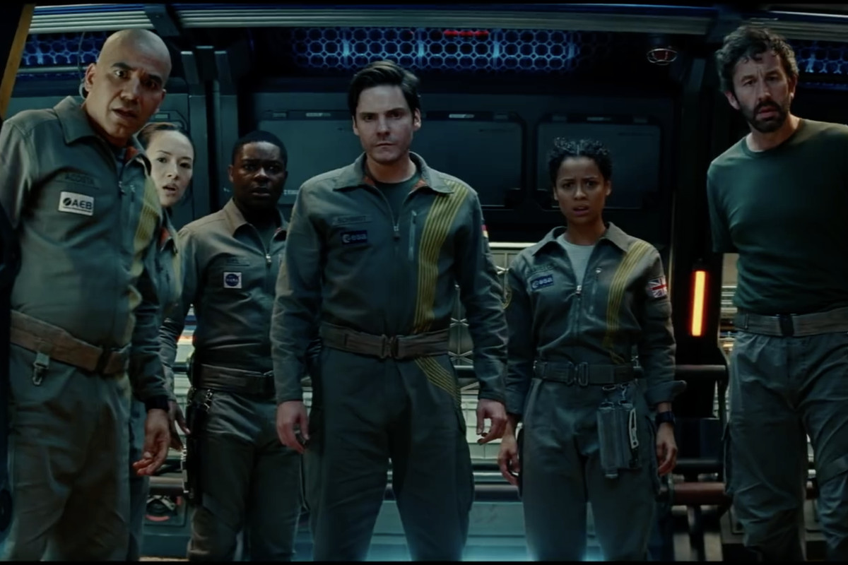 """A screenshot from the Netflix-produced movie trailer for """"The Cloverfield Paradox"""" shows the actors in sci-fi military garb."""