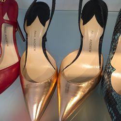 Rose gold and black heels, $225