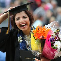 Shiva Sanavi celebrates after receiving her degree during Salt Lake Community College's commencement ceremony at the Maverik Center in West Valley City on Friday, May 6, 2016.
