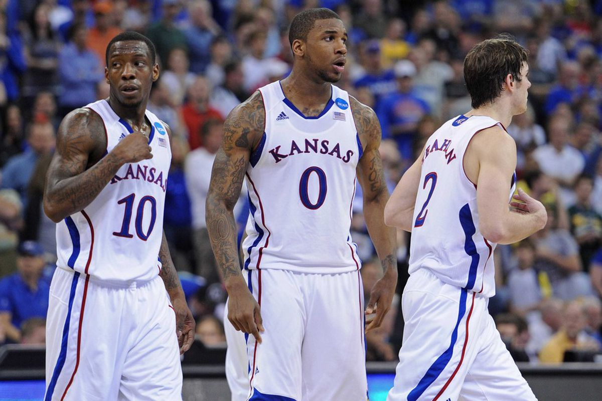 Kansas Jayhawks players Tyshawn Taylor (10), Thomas Robinson (0) and Conner Teahan (2) walk out onto the court against the Purdue Boilermakers during the second half of an NCAA men's basketball tournament game.  Kansas defeated Purdue 63-60.