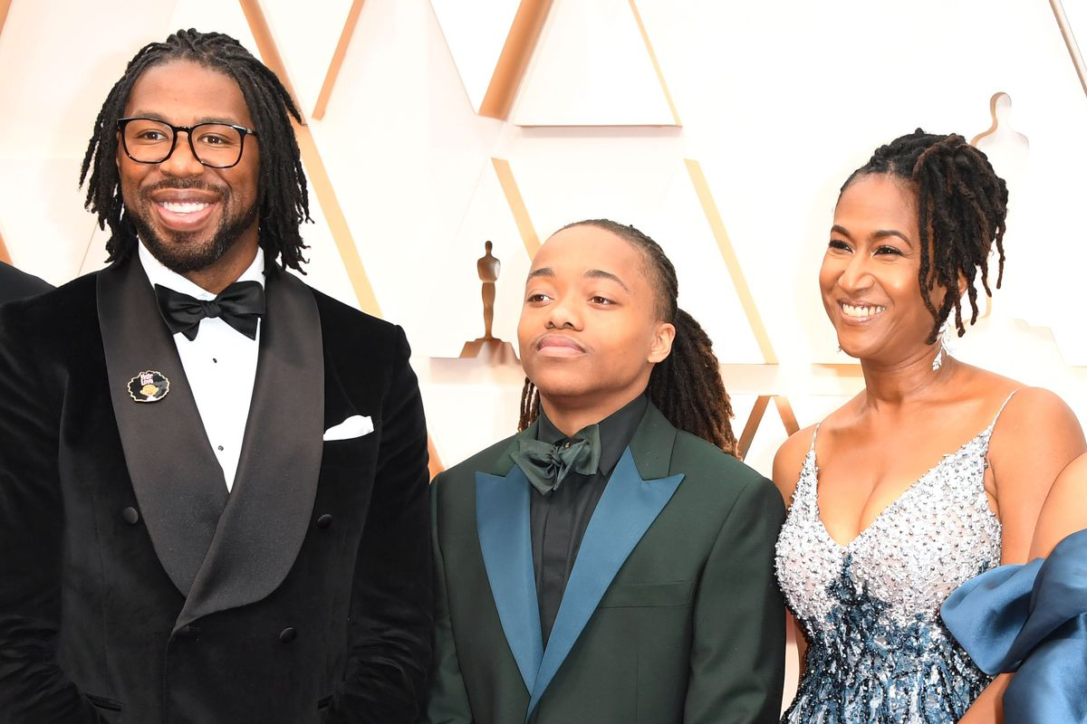 """""""Hair Love"""" director Matthew A. Cherry (from left), Texas high school student DeAndre Arnold and the film's producer Karen Rupert Toliver arrive for the 92nd Oscars telecast on Sunday night."""