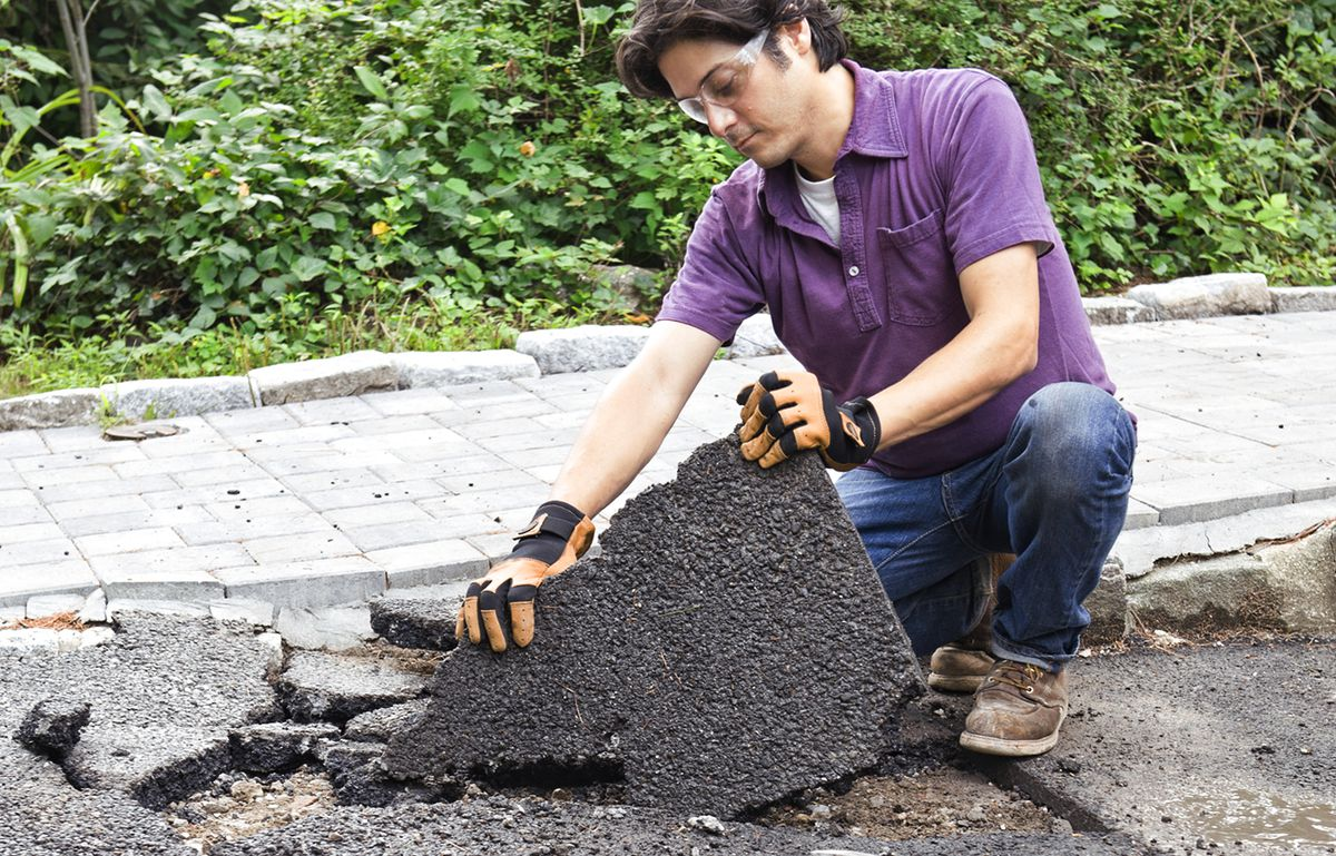 Man Removes Remaining Slab From Driveway