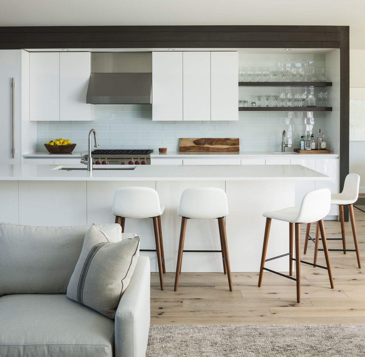 Kitchen with white barstools