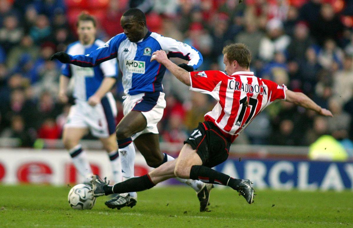 Dwight Yorke of Blackburn Rovers fends off Jody Craddock