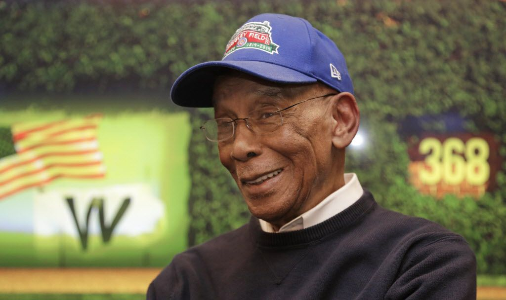 In this March 24, 2014, photo Chicago Cubs' Hall of Famer Ernie Banks talks during an interview at the Cubs offices in Chicago. (AP Photo/M. Spencer Green)