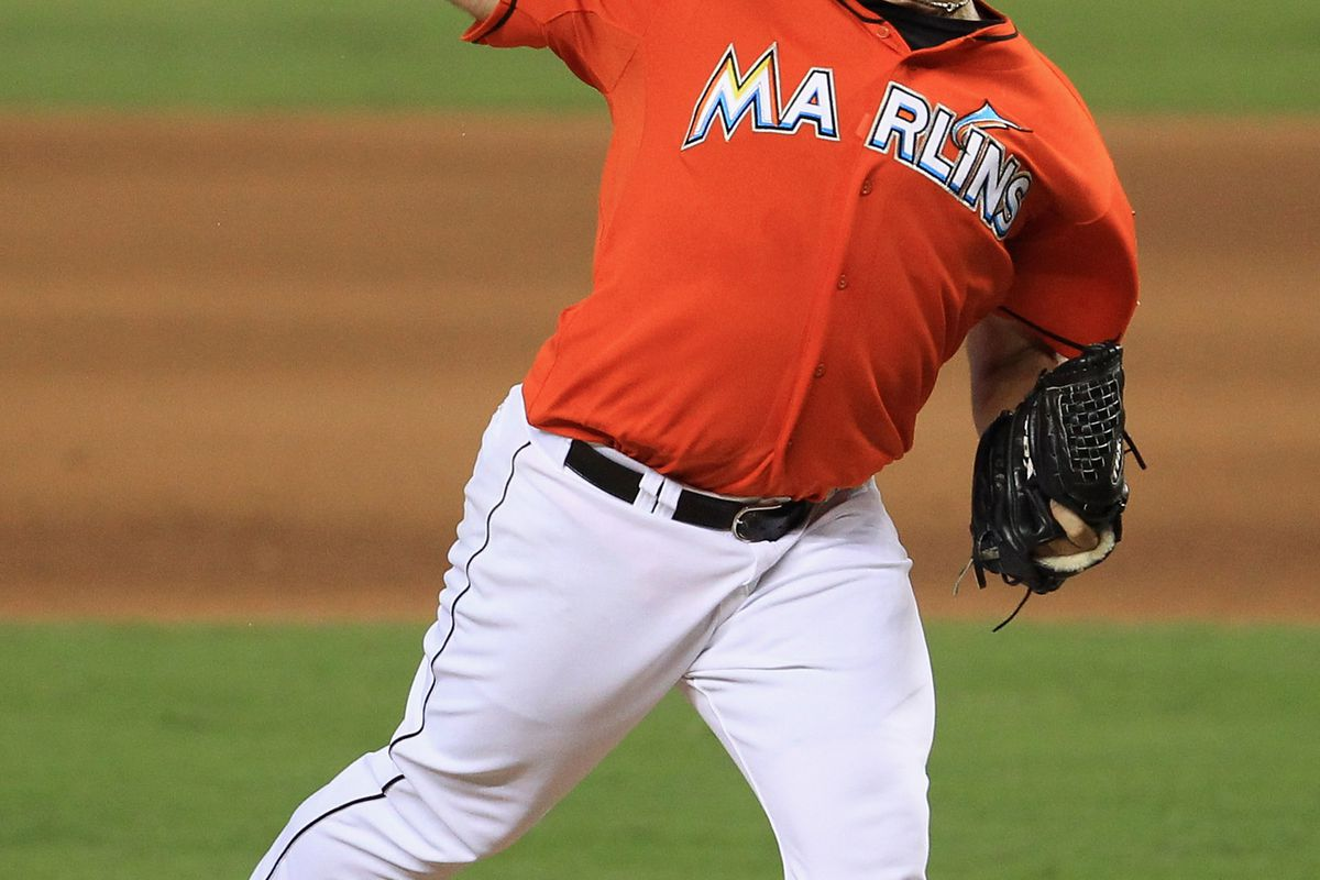 MIAMI, FL - JULY 15: Heath Bell #21 of the Miami Marlins delivers a pitch against the Washington Nationals at Marlins Park on July 15, 2012 in Miami, Florida. (Photo by Chris Trotman/Getty Images)