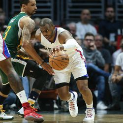 LA Clippers guard Chris Paul (3) drives around Utah Jazz guard George Hill (3) in the first half of game five of the first round NBA playoffs series between the Utah Jazz and the Los Angeles Clippers at the Staples Center in Los Angeles on Tuesday, April 25, 2017.