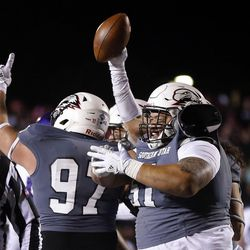 Southern Utah Thunderbirds celebrate a fumble recovery against the Weber State Wildcats during NCAA football in Cedar City on Saturday, Dec. 2, 2017.