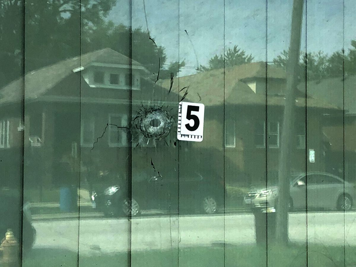 A bullet hole in a window at the Harvey home where an 11-year-old girl was critically wounded Sept. 23, 2019.