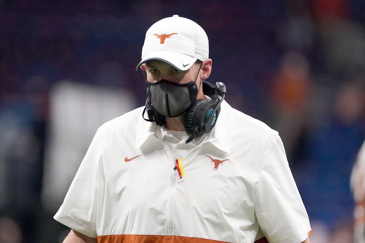 Texas Longhorns coach Tom Herman wears a face mask on the sidelines in the second half against the Colorado Buffaloes during the Alamo Bowl at the Alamodome.
