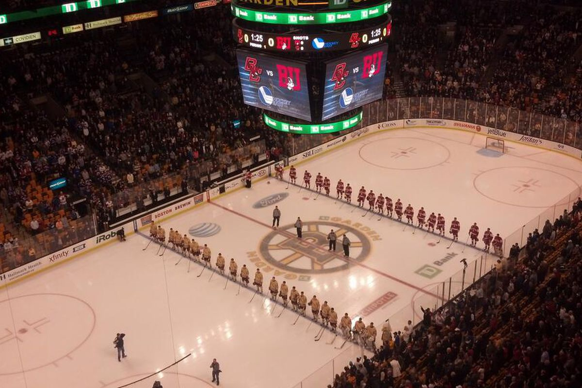Boston University and Boston College line up for the national anthem before tonight's semifinal