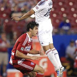 Real Salt Lake Alvaro Saborio (15) jumps for a header against FC Dallas Yordany Alvarez  (14) during the first half of an MLS soccer game on Wednesday, April 25, 2012, in Frisco, Texas. (AP Photo/LM Otero)