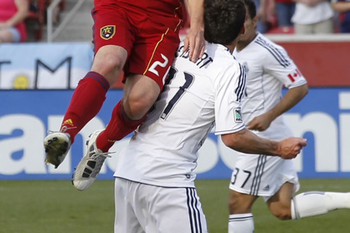 SANDY, UT - JUNE 4: Ned Grabavoy #20 of Real Salt Lake heads the ball over Russell Teibert #31 of Vancouver Whitecaps during the first half of an MLS soccer game June 4, 2011 at Rio Tinto Stadium in Sandy, Utah. (Photo by George Frey/Getty Images)
