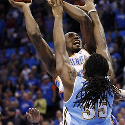 Oklahoma City Thunder forward Serge Ibaka, left, is fouled by Denver Nuggets forward Kenneth Faried (35) on a shot during the first quarter of an NBA basketball game in Oklahoma City, Wednesday, April 25, 2012.