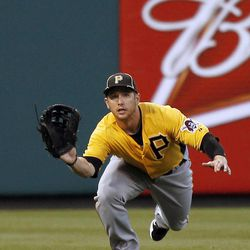 Pittsburgh Pirates left fielder Alex Presley dives for, but misses, a double by Philadelphia Phillies' Juan Pierre in the first inning of an exhibition baseball game Monday, April 2, 2012, in Philadelphia.
