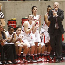 Utah's Head Coach Anthony Levrets and the bench cheer for their team as Utah and Utah State play Nov. 27, 2012, in the Huntsman Center. Utah won 92-64.