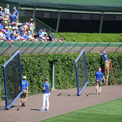 2:22 p.m. Batting practice screens being moved, while balls are being retrieved from the basket -