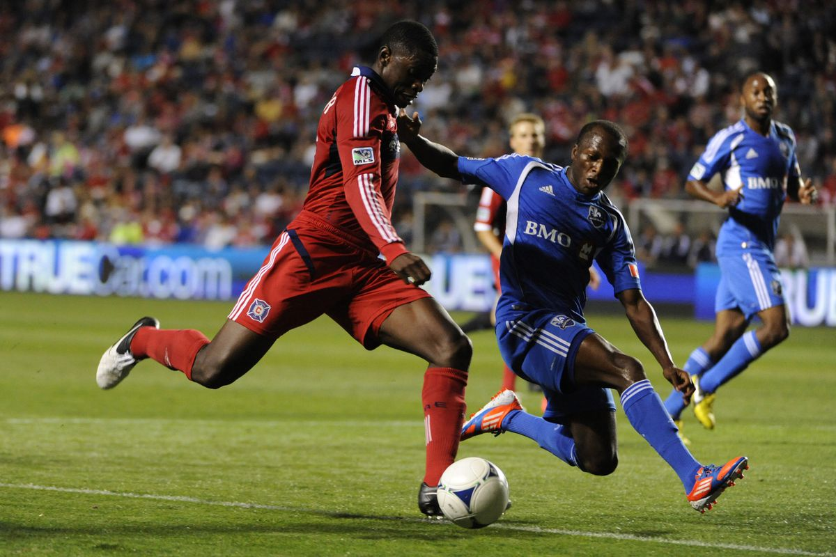BRIDGEVIEW, IL - SEPTEMBER 15: Jalil Anibaba #6 of Chicago Fire is defended by Sanna Nyassi #11 of Montreal Impact in an MLS match on September 15, 2012 at Toyota Park in Bridgeview, Illinois.   (Photo by David Banks/Getty Images)