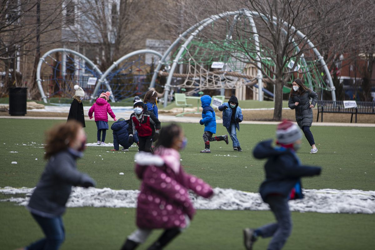 Students play outside at Hawthorne Scholastic Academy.