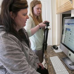 Megan Palmer and her mom Marla try unsuccessfully try to connect with Megan's cousin Jenica Woolley who lives in Qatar Wednesday, March 6, 2013. Megan and her cousin Jenica worked on and produced a short film talking about Albinism.