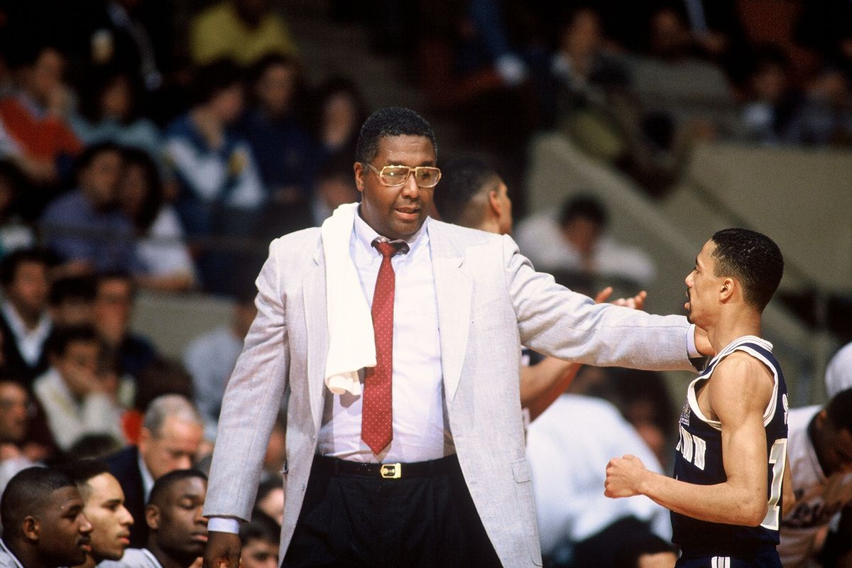 Coach John Thompson With Charles Smith