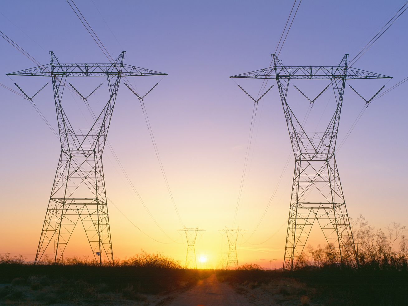 Sunset on electrical transmission towers near Lancaster, California.