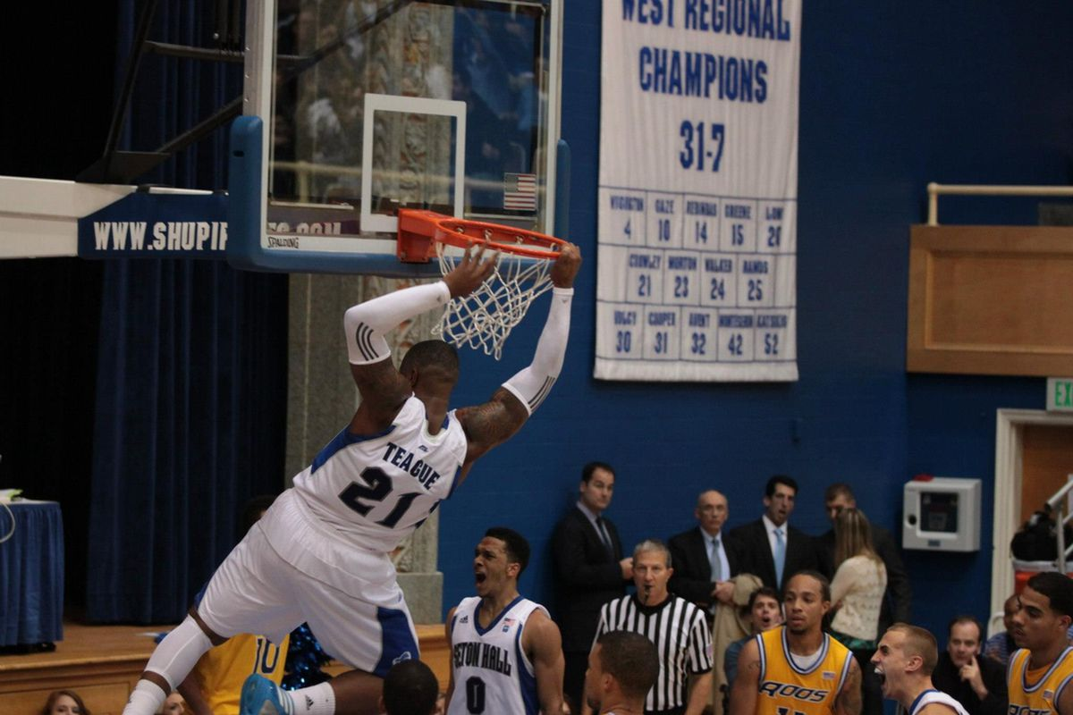 The rim held, but numerous jaws dropped following Eugene Teague's thunderous dunk assisted by Tom Maayan.