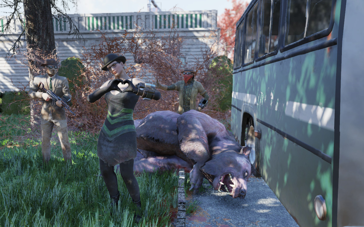 Fallout 76 - three players stand over a fallen Yao Guai in Whitesprings.