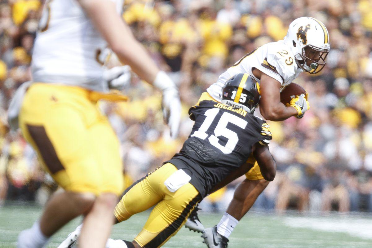 Iowa CB Josh Jackson tackles Wyoming RB Kellen Overstreet