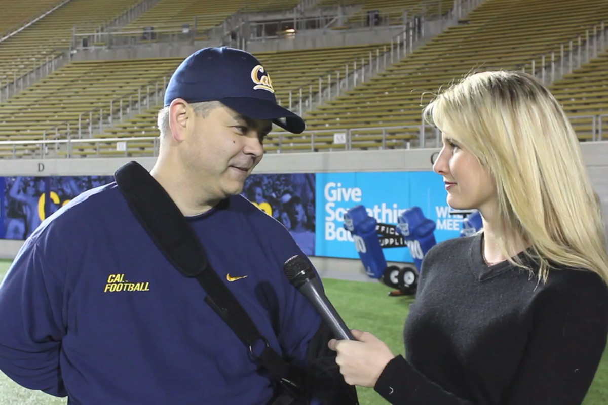 Cal defensive coordinator Andy Buh talks to Lindsay Brauner