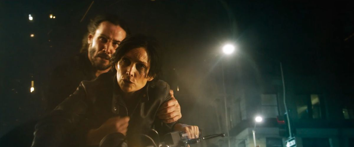 Neo and Trinity motorcycle riding in The Matrix Resurrections