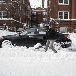 Kevin Sullivan shovels out his car near N. Janssen Ave. and W. Cornelia Ave. in the Lakeview neighborhood, Tuesday, Feb. 16, 2021.