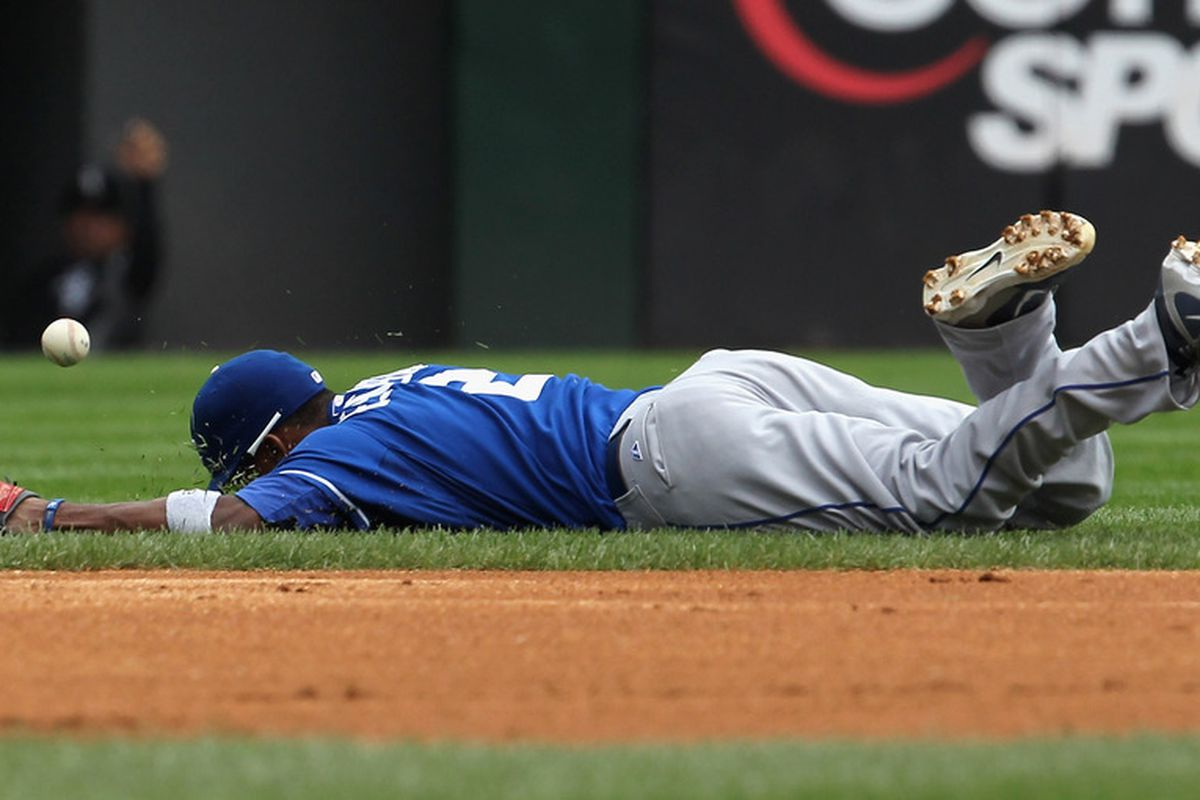 CHICAGO, IL - AUGUST 14: Alcides Escobar #2 of the Kansas City Royals dives but misses a ball against the Chicago White Sox at U.S. Cellular Field on August 14, 2011 in Chicago, Illinois. (Photo by Jonathan Daniel/Getty Images)