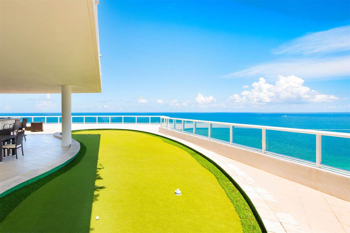 The terrace of Unit 2203 at the Ritz-Carlton Fort Lauderdale Beach with an ocean view and putting green