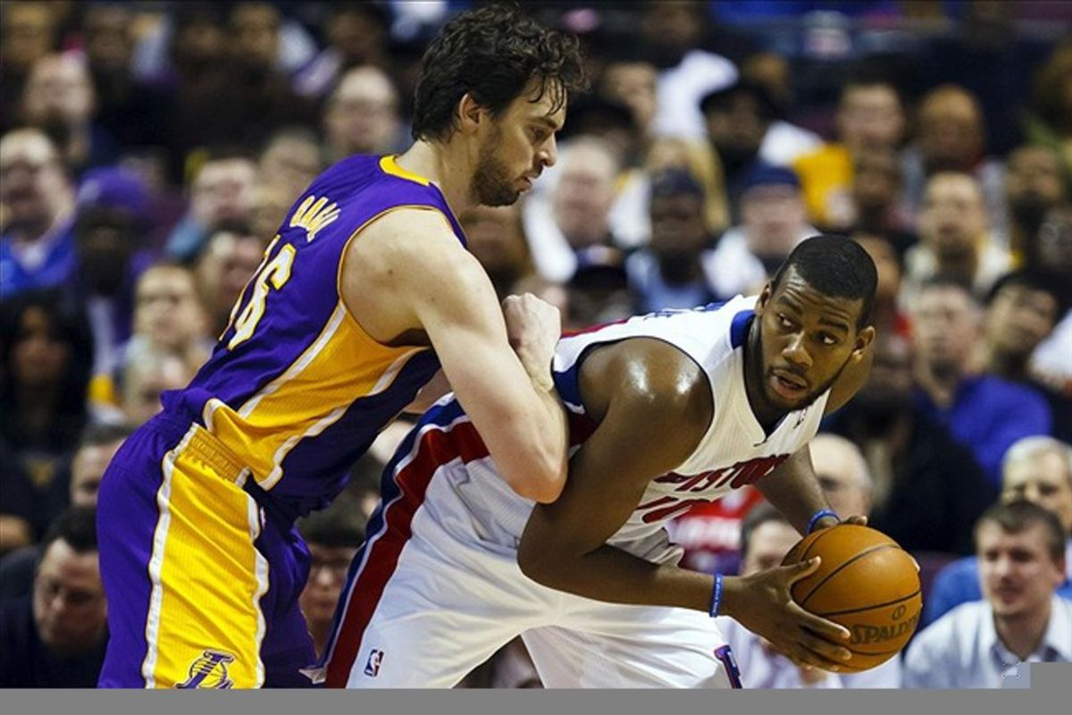 March 6, 2012; Auburn Hills, MI, USA; Detroit Pistons center Greg Monroe (10) is defended by Los Angeles Lakers power forward Pau Gasol (16) in the first quarter at The Palace. Mandatory Credit: Rick Osentoski-US PRESSWIRE