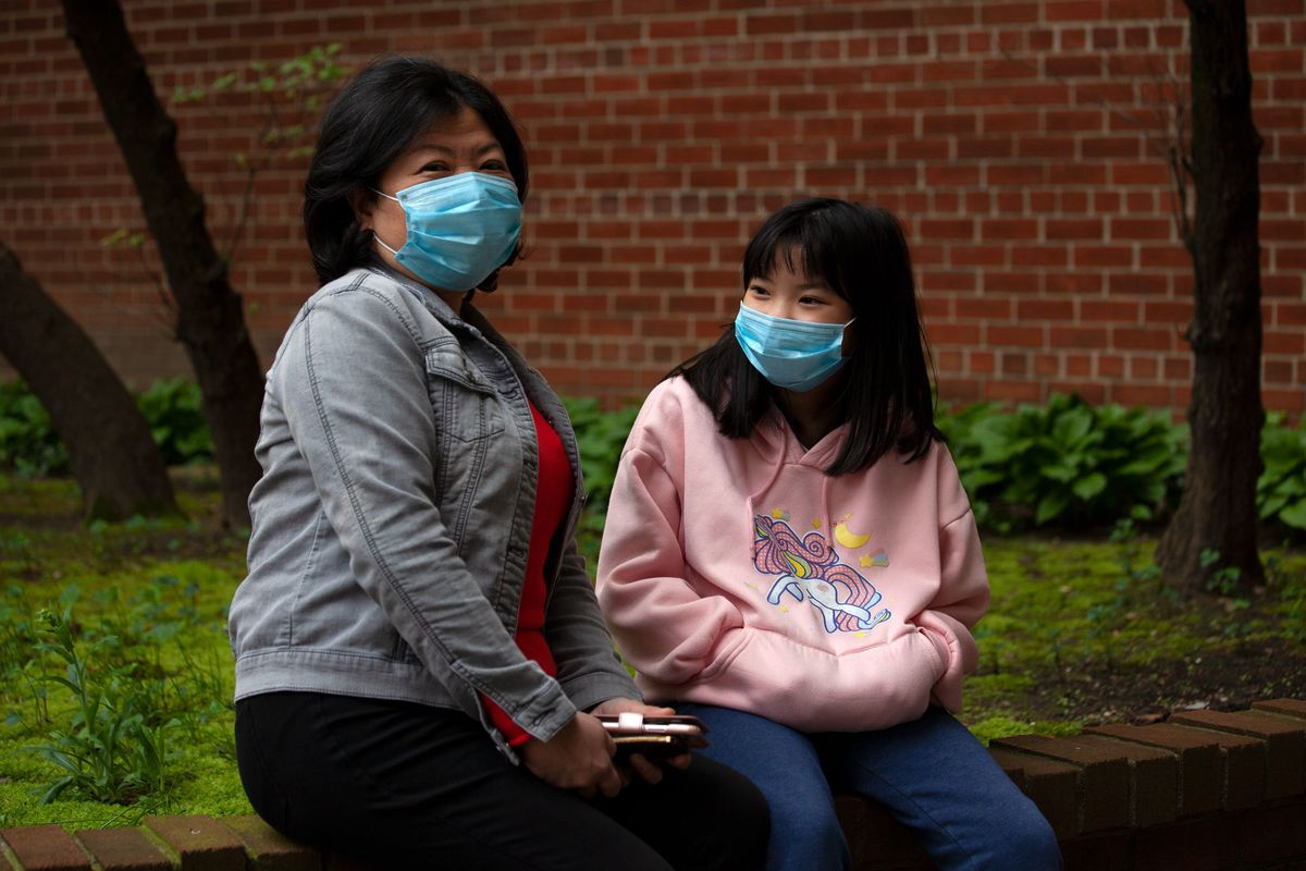 Elaine Wong spends time with her daughter, Kimberly, outside their Flushing home after the mother lost her job at the Beekman Hotel during the coronavirus outbreak.