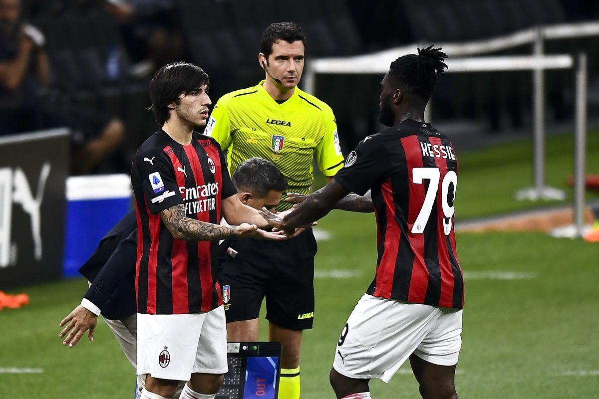 Sandro Tonali (L) of AC Milan replaces Franck Kessie of AC...