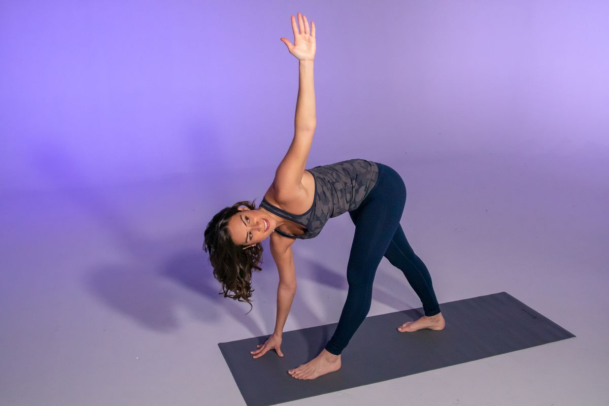 Stephanie Mansour in the final position of a revolving triangle, part of her yoga detox workout.