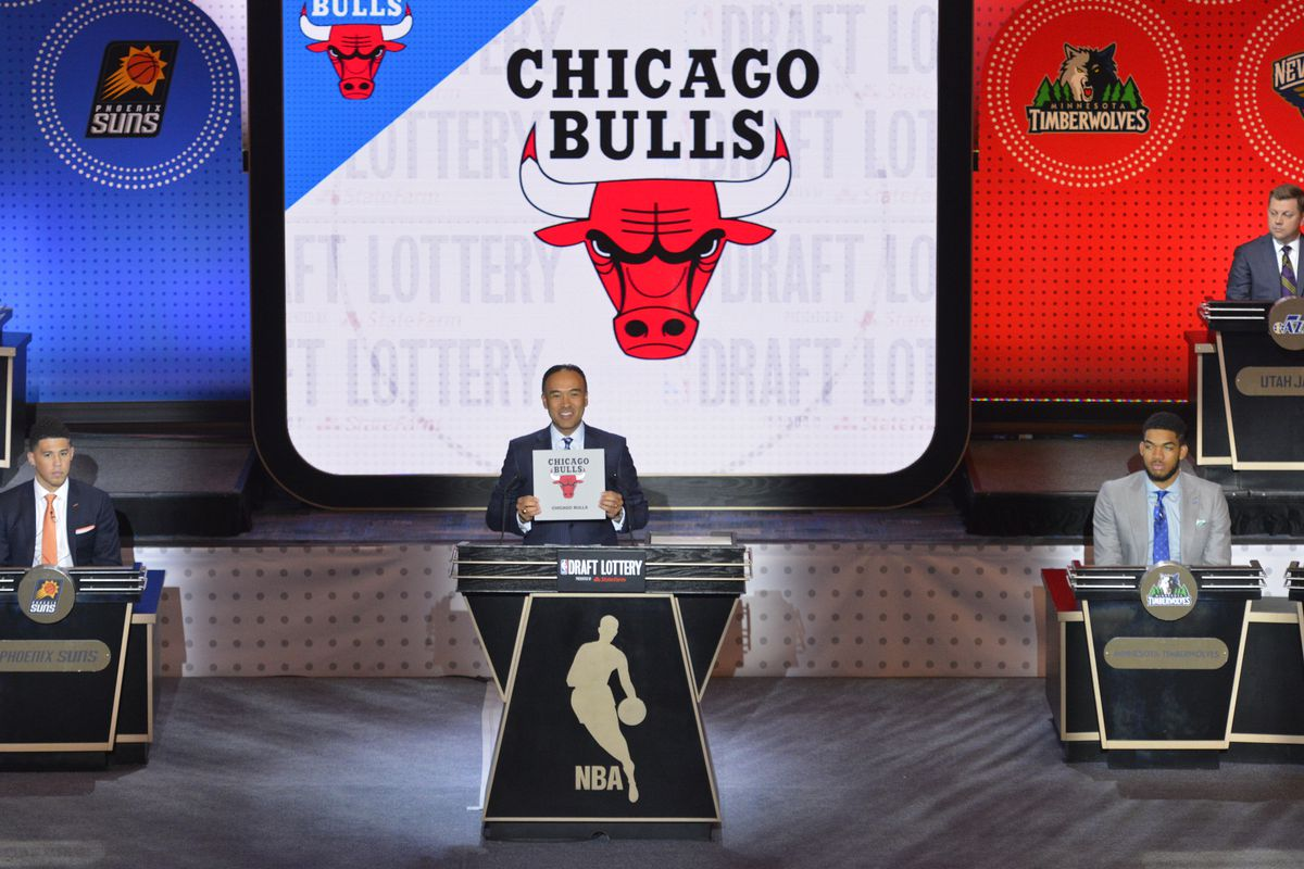 Mark Tatum, NBA's deputy commissioner, announces the Chicago Bulls as the #14 pick during the 2016 NBA Draft Lottery at the New York Hilton in New York, New York.