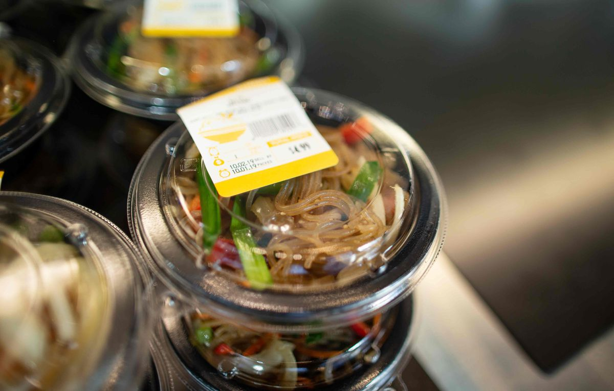 A closeup of a packaged noodle dish.