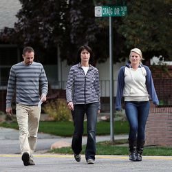 Family members walk forward to talk with the media about Russell Jacobs in East Millcreek, Friday, Oct. 30, 2015. They are  Brian Stolk, nephew, Lyne Miller, a cousin to Russell Jacobs' wife, and Kallie Stolk, niece. Russell Jacobs died after being shot Oct. 29, 2015.