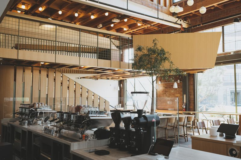 The long coffee bar, with grinders and dual espresso machines.