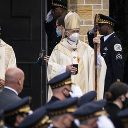 Archdiocese of Chicago Cardinal Blase Cupich walks in front of the casket for Chicago Police Officer Ella French as pallbearers carry her casket to the hearse after her funeral at St. Rita of Cascia Shrine Chapel, Thursday, Aug. 19, 2021. Officer French was fatally shot and her partner was critically wounded while in the line of duty on Aug. 7 in West Englewood.