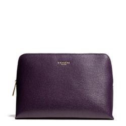"""<a href=""""http://f.curbed.cc/f/Coach_111913_Cosmetic"""">Cosmetic Case in Black Violet</a>, $88"""