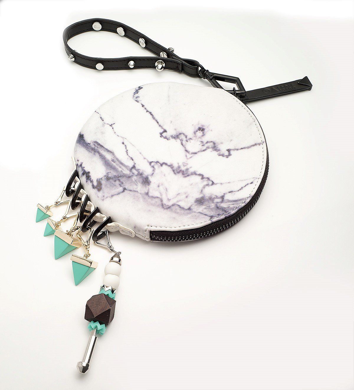 Small circle bag ($20) with assorted charms and studs ($8 to $13). Photo: Vogue