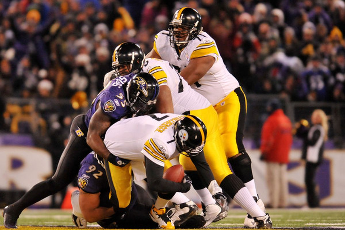 The most hideous man in football sacks the second most hideous man in football. Go Ravens!